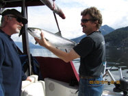 Predator Charters - Skipper letting you kiss your catch!